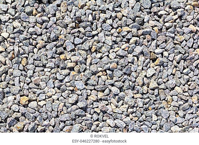 Many small and gray stones, seamless texture