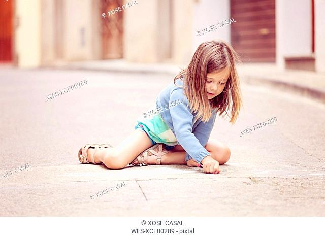 Girl drawing in the street