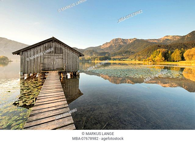 Boat hut at Kochelsee against Herzogstand and Heimgarten, Upper Bavaria, Bavaria, Germany
