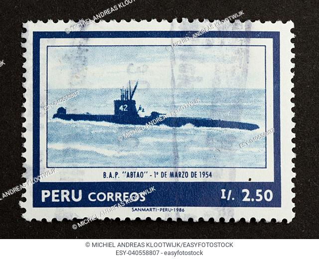 PERU - 1986: Stamp printed in the Peru shows a picture of an old diesel submarine, 1986