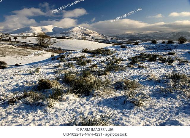 Looking across snowcovered Howgill fells towards Sedbergh with Garsdale and Dent in the distance. Cumbria - England. (Photo by: Wayne Hutchinson/Farm...