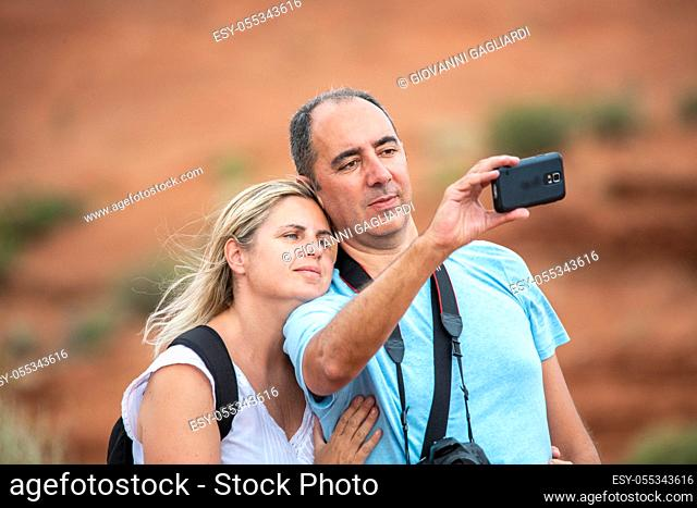 Happy couple taking selfie in the national park
