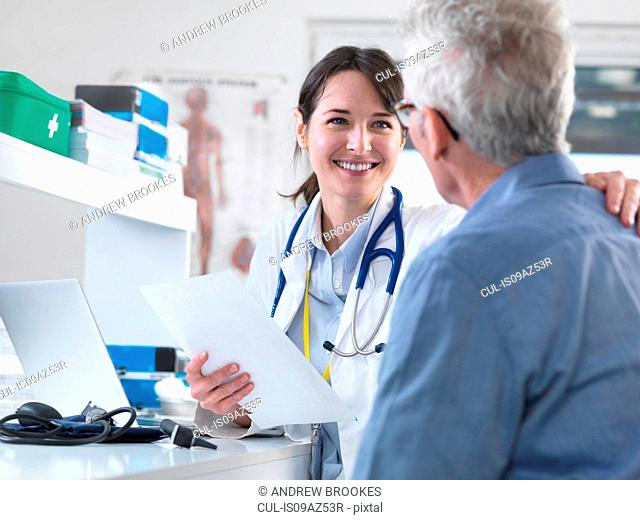 Doctor sharing good results with patient in clinic