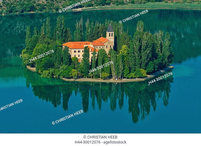 Europe, Balkan, Croatia,Krka National Park, the Krka Monastery, built above ancient Roman catacombs. Visovac Island is home to the 15th-century Franciscan...