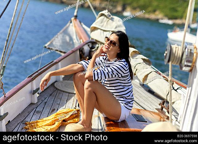 Young woman with sailor clothes, Sailing boat, Pasaia port, Gipuzkoa, Basque Country, Spain, Europe