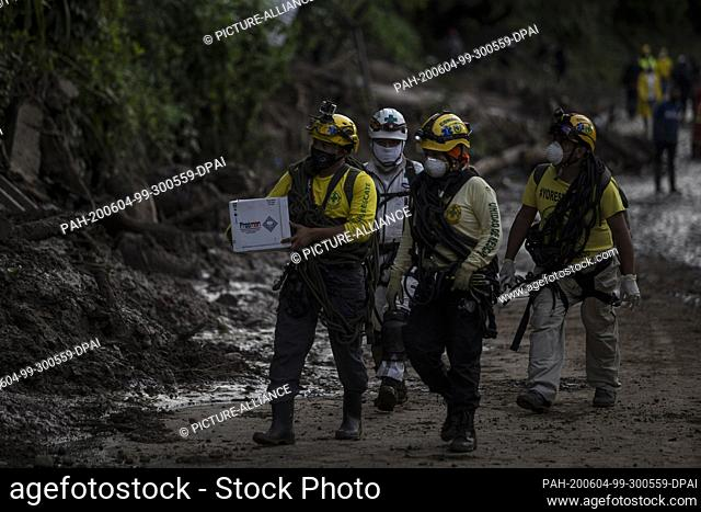 03 June 2020, El Salvador, Santo Tomás: A group of rescue workers sets out to search for missing persons after severe storms