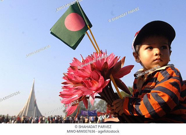 Portrait of a child boy on the neck of his father at the National Memorial Monument Jatyo Sriti Shaudho in Savar on December 16, 2005 Dhaka, Bangladesh