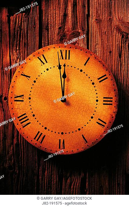 Old clock on wooden wall