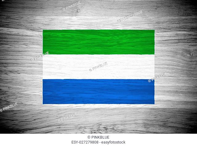 Sierra Leone flag on wood texture