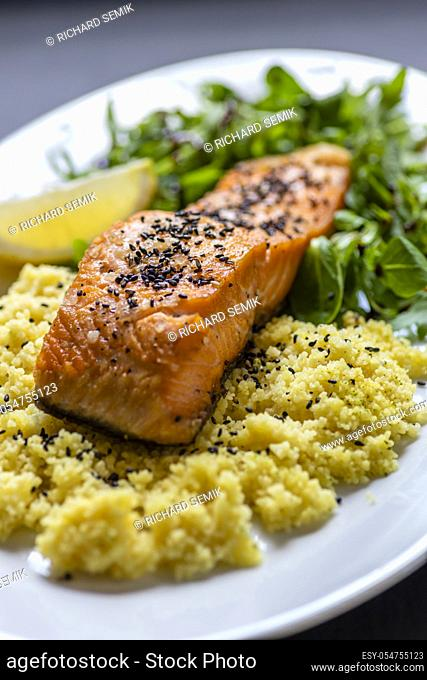 baked salmon with spinach salad and couscous