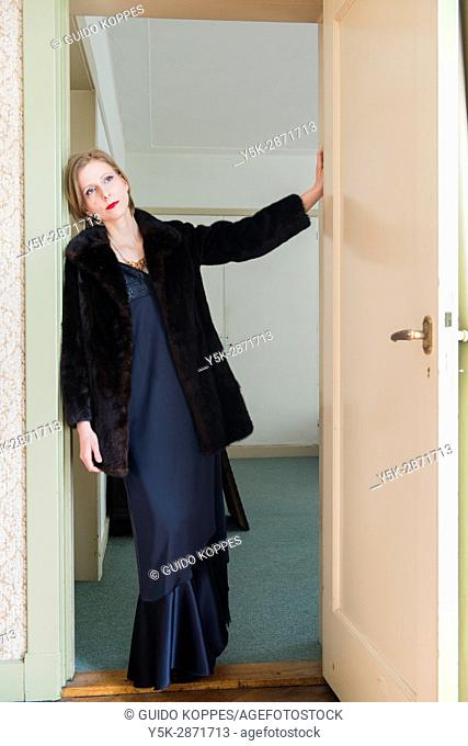 Tilburg, Nederland, Adult caucasian woman wearing evening dress getting ready to go out to a classical concert