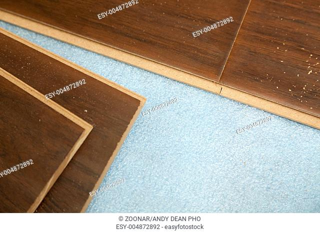 Newly Installed Brown Laminate Flooring, Baseboard