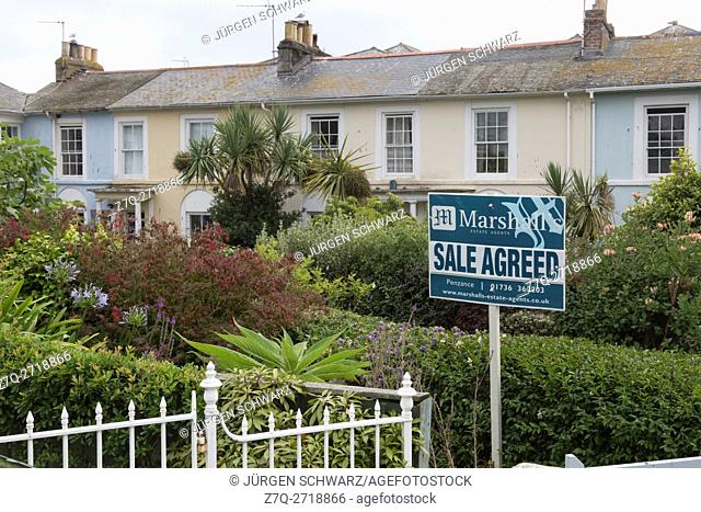"""Sign """"""""sale agreed"""""""" in front of a house in Penzance, Cornwall, UK"""