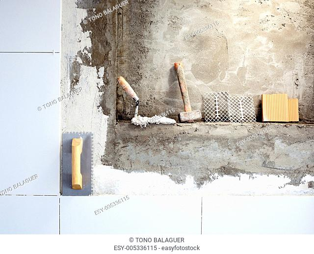 construction tools notched trowel and hammer