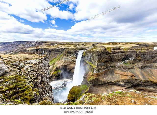 A gorgeous high angle landscape viewpoint overlooking the Haifoss waterfall valley, a popular hiking destination for travellers in Iceland; Iceland
