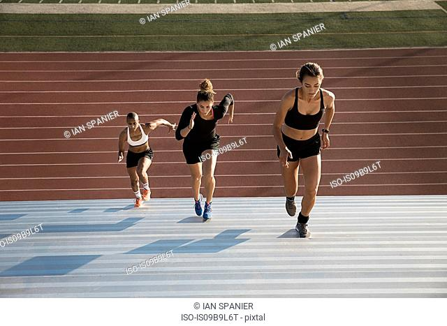High angle view of woman running up steps