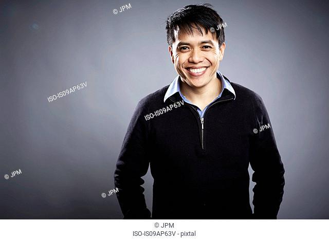Portrait of mid adult man, smiling