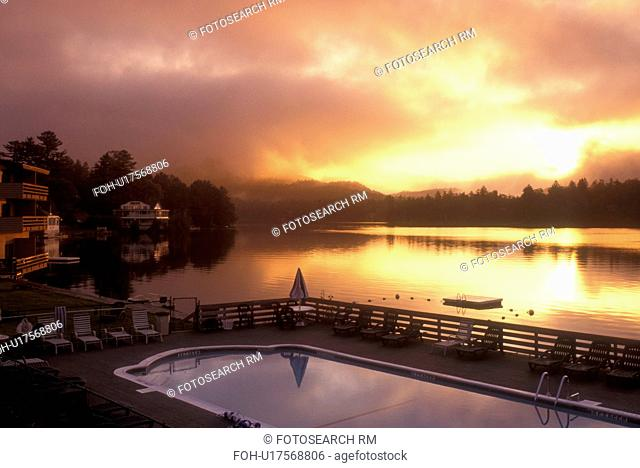 Lake Placid, Adirondacks, Adirondack Park, New York, A scenic view of[sunrise, sunset, morning, evening] from the swimming pool at the Hilton Resort on Mirror...