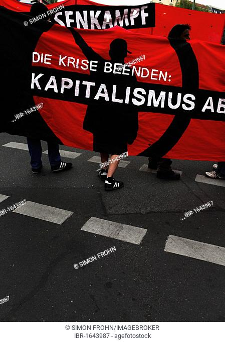 Poster and demonstrators at the revolutionary 1st may rally, 1. Mai Kundgebung in german, Berlin, Germany, Europe