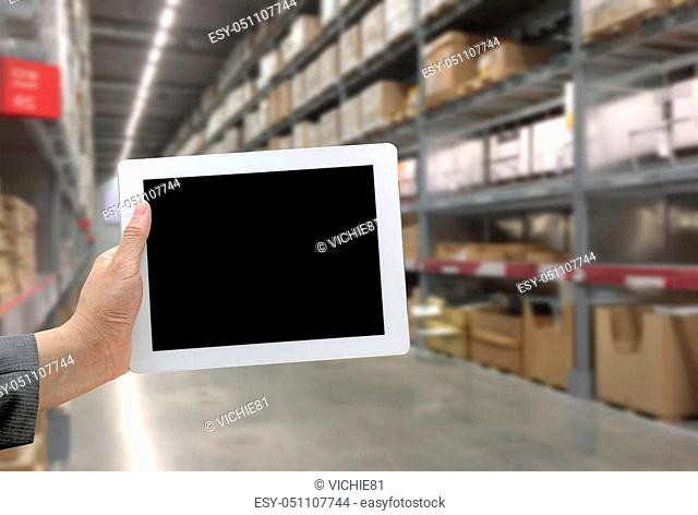 Abstrast Blurred background: Warehouse cargo with digital tablet