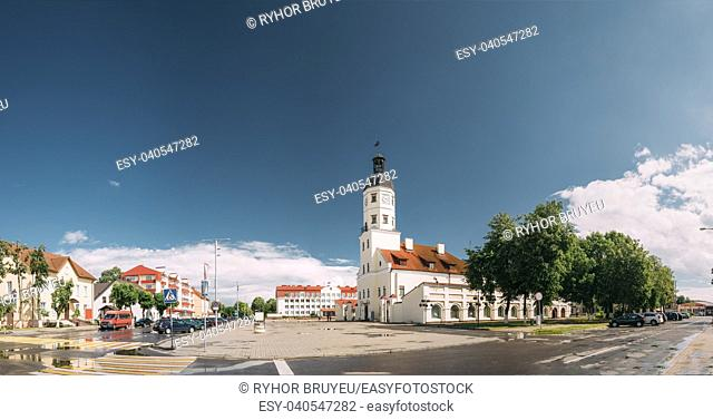Nesvizh, Minsk Region, Belarus. Panoramic View Of Square And Town Hall In Summer Sunny Day. Famous Landmark In Nyasvizh. Architecture Of 16th Century