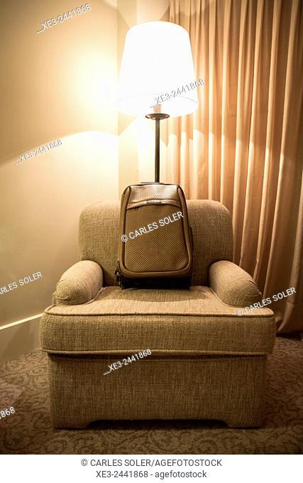 Trolley case on armchair