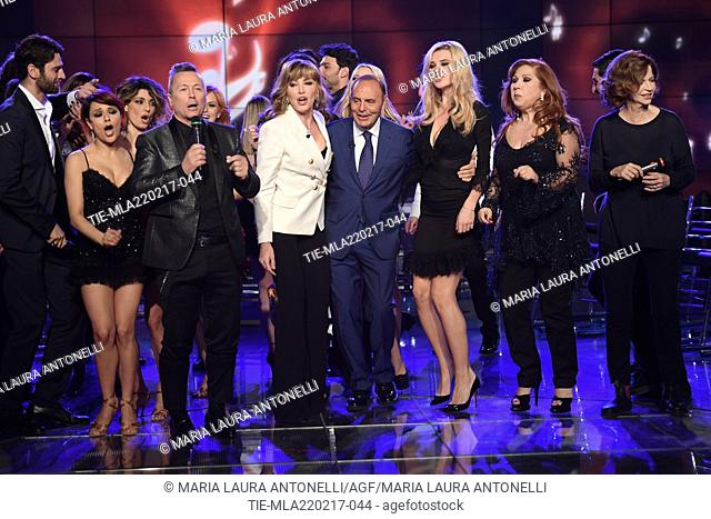 Hosts Paolo Belli, Milly Carlucci, Bruno Vespa dancing with the cast during the tv show Porta a porta, Rome, ITALY-21-02-2017