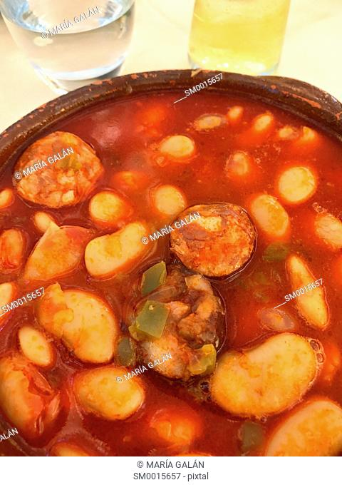Beans stew with chorizo and vegetables. Spain