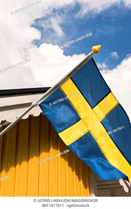 Swedish flag on yellow wall, Sweden, Scandinavia, Europe