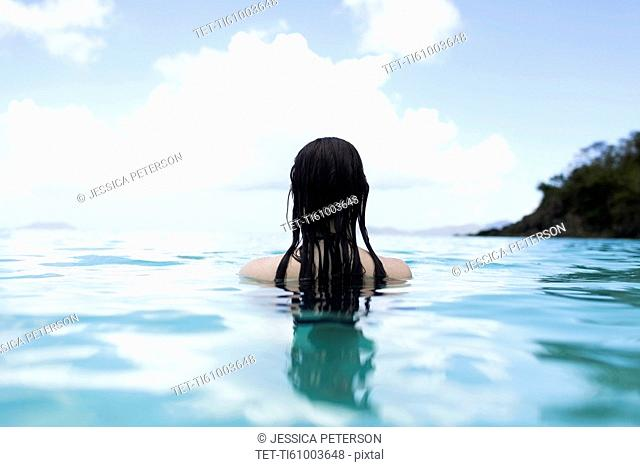 USA, Virgin Islands, Saint Thomas, Woman with long hair standing in bay