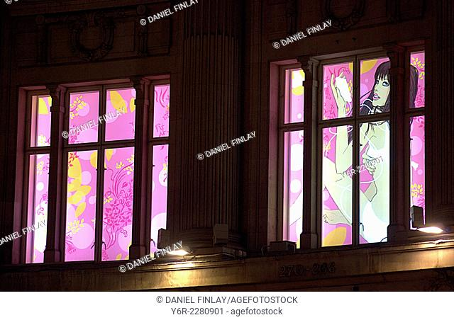 First floor window decoration of shop right on Oxford Circus, in the heart of London, England, at night