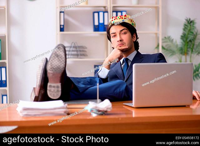Young king businessman working in the office