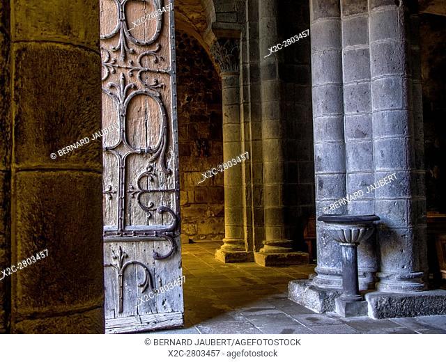 Orcival village. Entrance of Romanesque church Notre-Dame d'Orcival. Puy de Dome. Auvergne. France