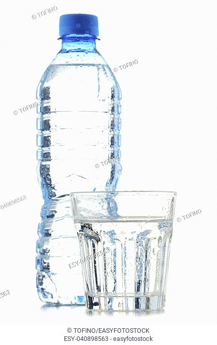 Bottle and glass of mineral water isolated on white background