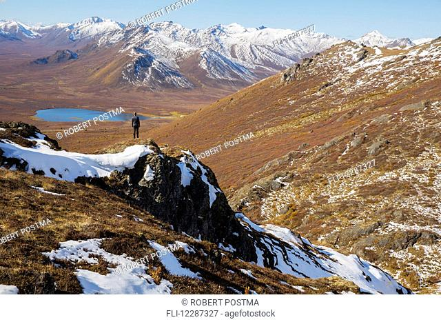 Hiking on top of Angelcomb Peak along the Dempster Highway; Yukon, Canada