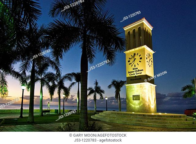 Tourist on evening stroll beside Eliza James-McBean Clock Tower, Frederiksted, St Croix, US Virgin Islands