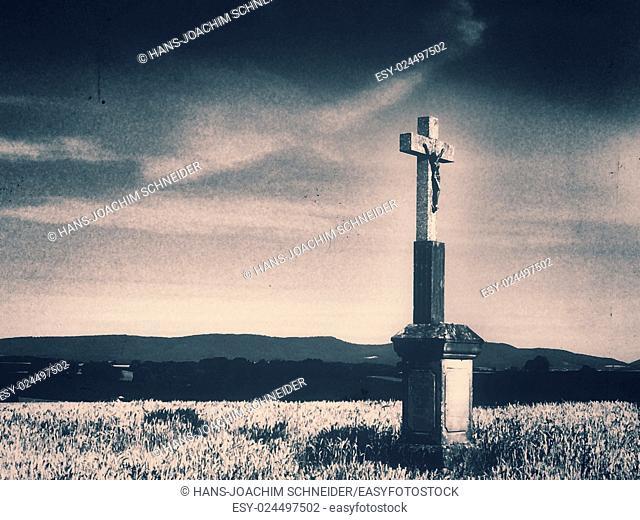 Cross in cornfield in retro style