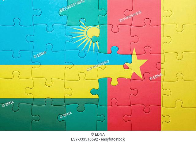puzzle with the national flag of rwanda and cameroon . concept