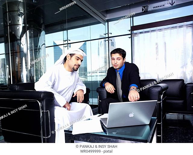 Business persons discussing
