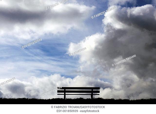 Garden seat with a dramatic sky