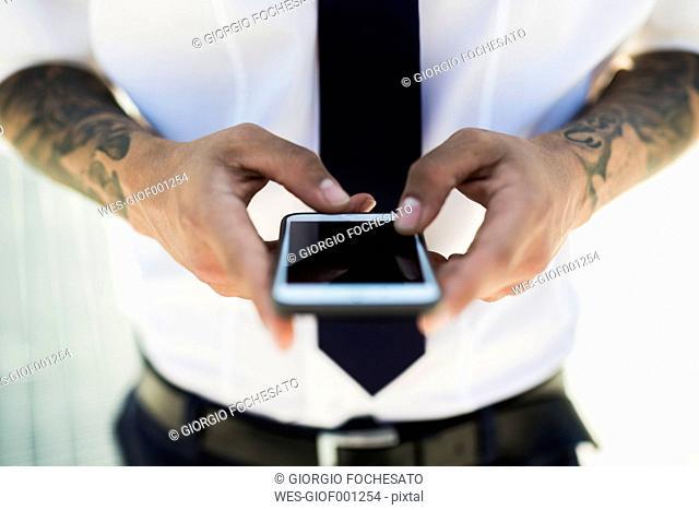 Man's hands text messaging, close-up