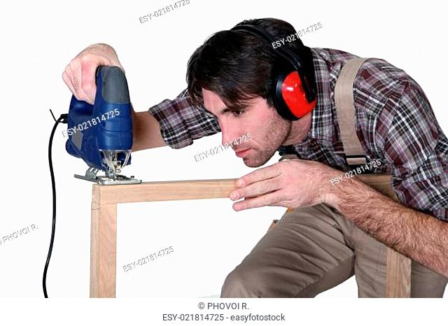 Carpenter making a frame