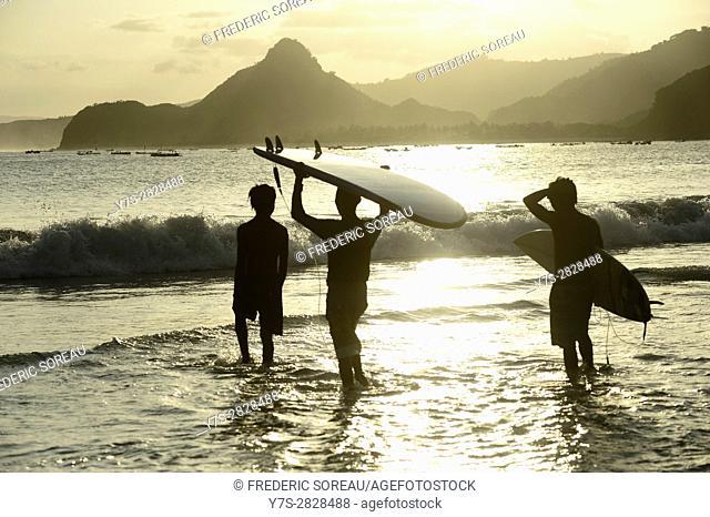 Surfers at Selong Blanak beach,South Coast,Lombok island,Indonesia