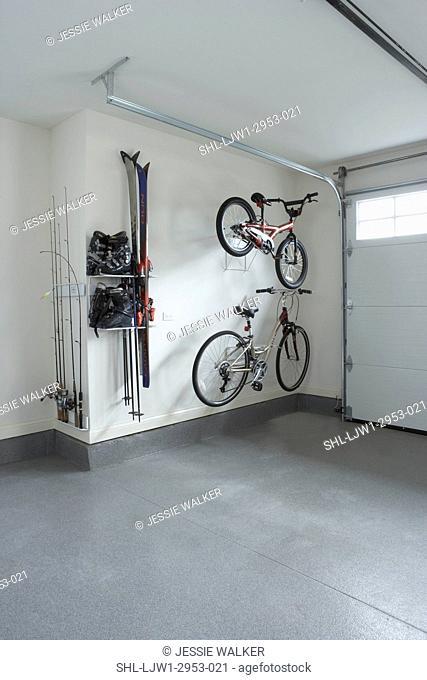 STORAGE: garage storage of sporting equipment, two bikes, ski boots and skiis, fishing gear