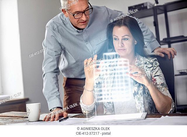 Female architect performing telekinesis, hovering futuristic glowing plastic model