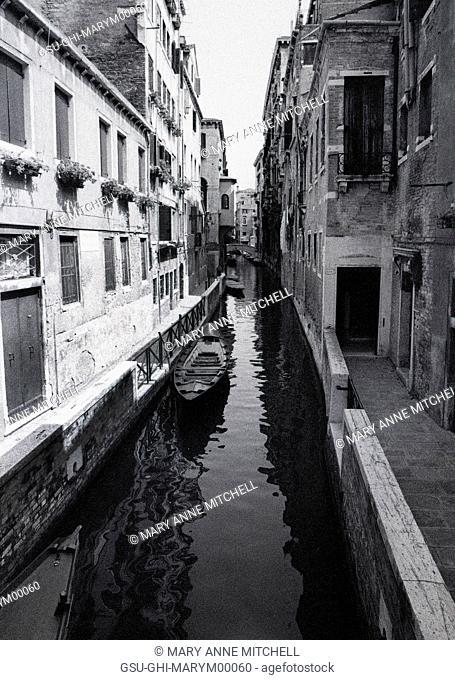 Boat in Narrow Canal, Venice, Italy