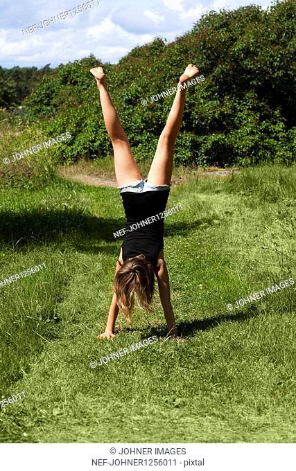 Girl performing handstand