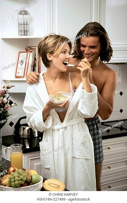 Couple in kitchen. Healthy breakfast