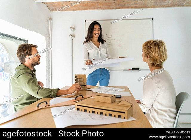 Colleagues having a meeting in architectural office