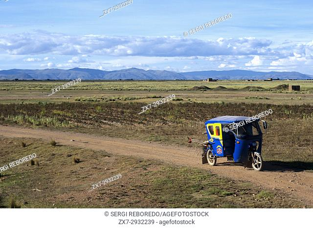 Tuc tuc in the Peruvian altiplano landscape seen from inside the Andean Explorer train Orient Express which runs between Cuzco and Puno
